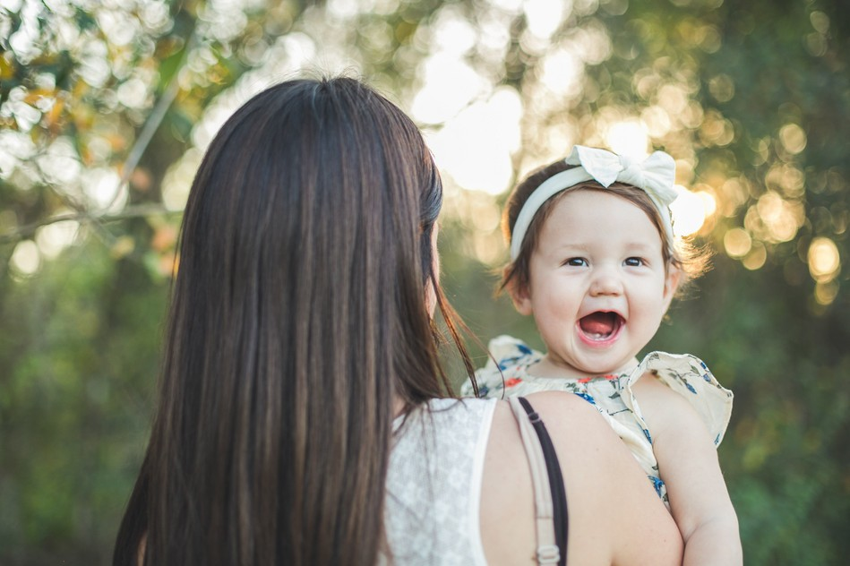 Mommy holding her little daughter   Family Session by Bára Miller Photography