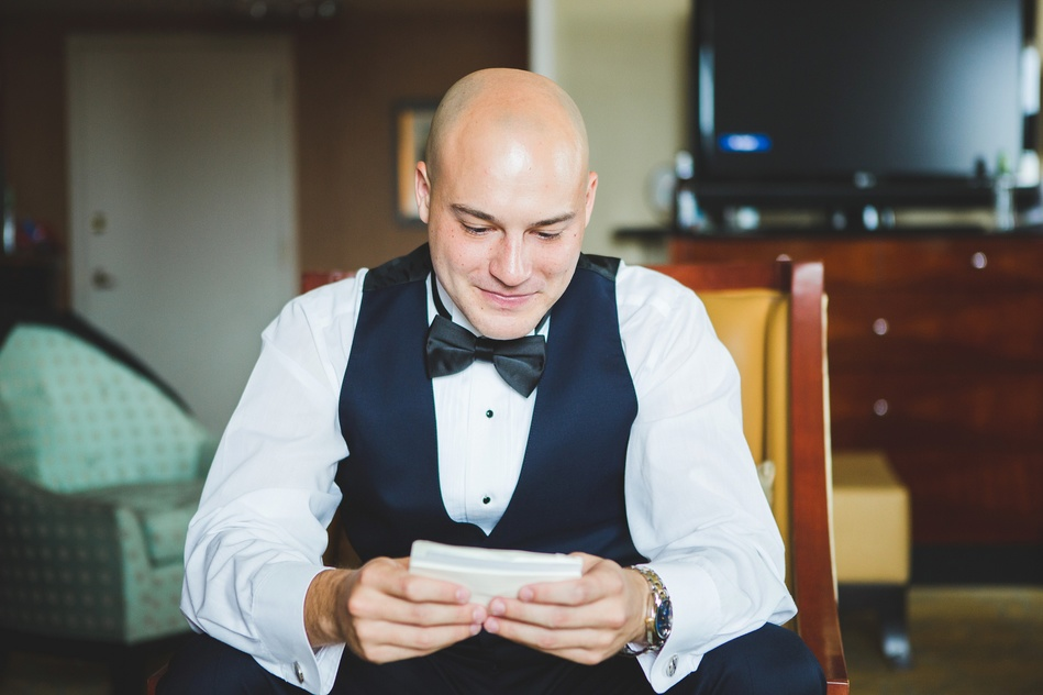 Groom ready a note from his soon to be bride at Tampa Waterside Marriott