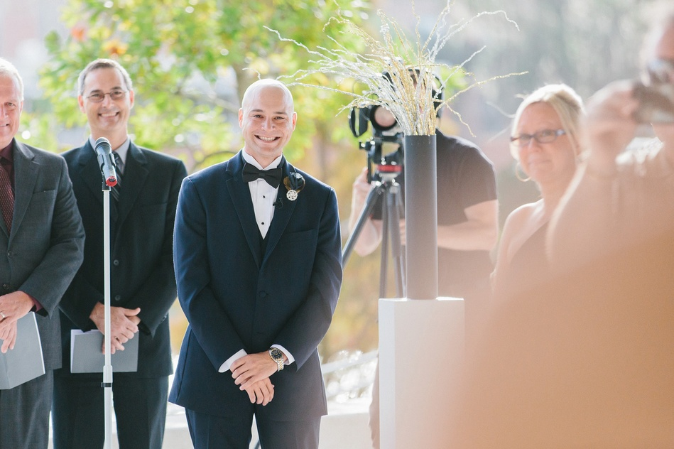 Groom looking at a bride at Tampa Museum of Art Wedding Ceremony by Bára Miller Photography