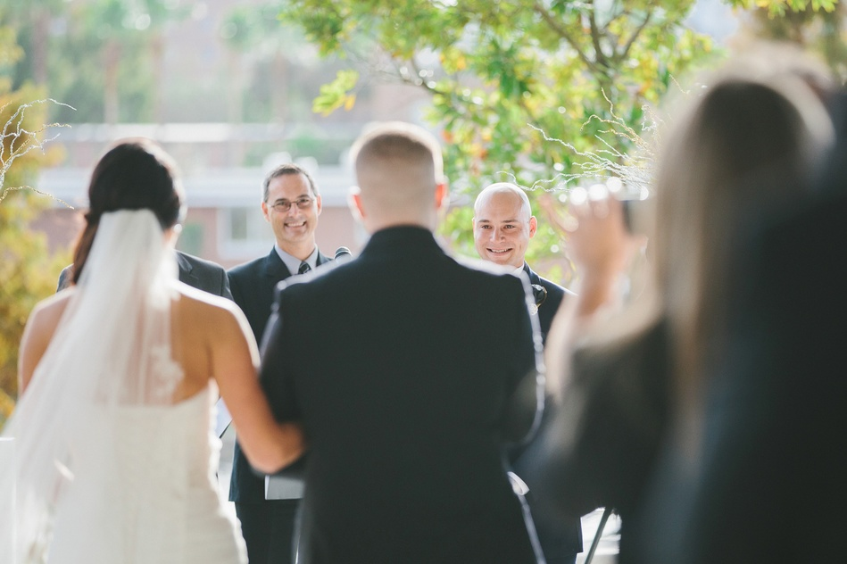 groom looking at his bride walking down the aisle at Tampa Museum of Art Wedding by Bara Miller Photography