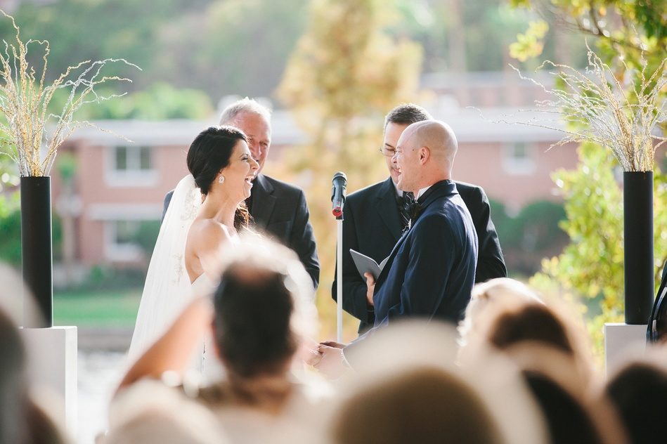 Bride and Groom laughing at Tampa Museum of Art Wedding Ceremony by Bara Miller Photography