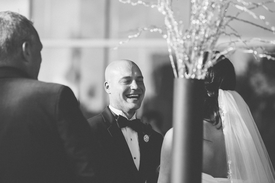 Groom laughing at Tampa Museum of Art Wedding by Bara Miller Photography