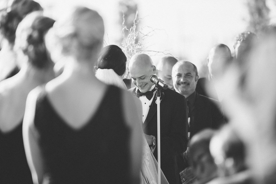 Candid image of groom reading his vows at Tampa Museum of Art Wedding by Bara Miller Photography
