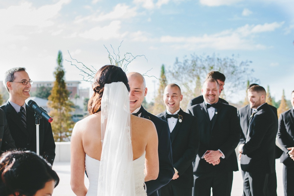 Groom and groomsmen laughing at Tampa Museum of Art Wedding Ceremony by Bara Miller Photography