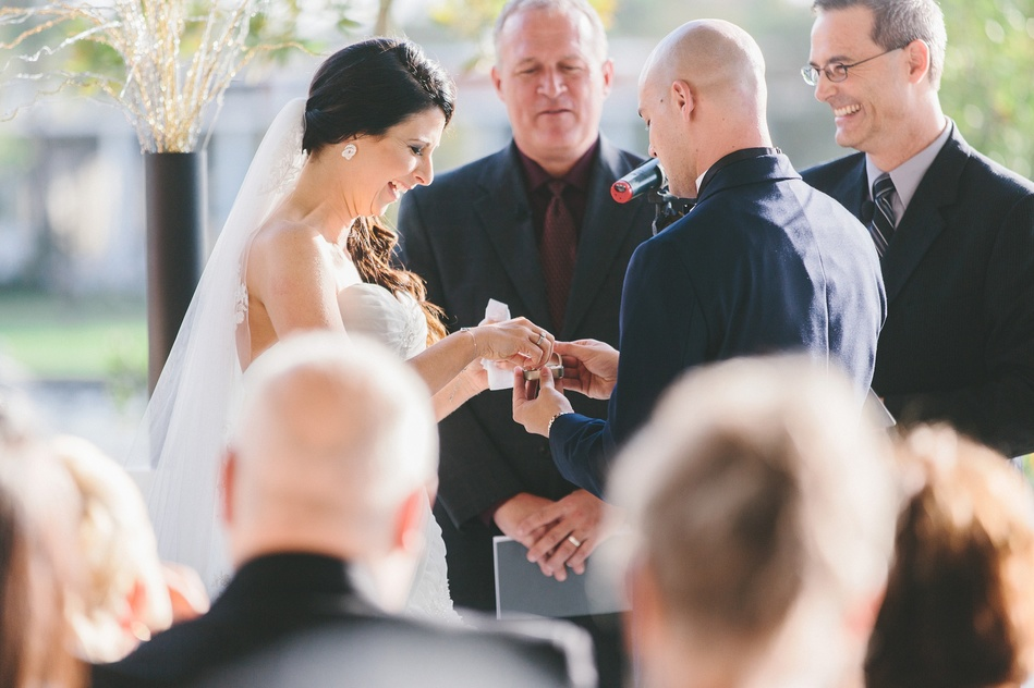 ring exchange at a wedding ceremony at Tampa Museum of Art Wedding by Bara Miller Photography