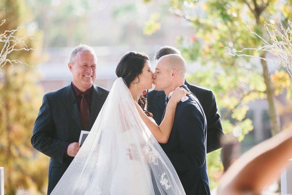 first kiss at a wedding ceremony at Tampa Museum of Art Wedding by Bara Miller Photography
